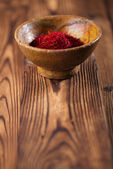 Saffron spice in earthenware bowl — Stock Photo