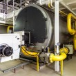 Interior gas boiler room with large boilers and burners — Stock Photo #28097719