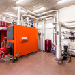 Interior industrial diesel boiler room with boilers and burners — Stock Photo #28097729