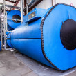 Big blue reservoirs in factory boiler room — Stock Photo #28097751