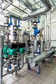Interior gas boiler room with multiple pumps and piping — Stock Photo