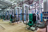 Interior gas boiler room with multiple pipelines and pumps — Stock Photo