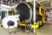 Interior gas boiler room with large boilers and burners — Stock Photo