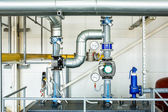 Equipment and piping industrial gas boiler room — Stock Photo