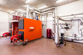 Interior industrial diesel boiler room with boilers and burners — Stock Photo