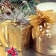 Christmas composition with golden gift box and golden candle, cl — Stock Photo