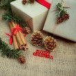 Christmas gift boxes and decorations, rustic style, closeup shot — Stock Photo