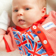 Stock Photo: Little Brtitish fan: newborn girl wearing British symbol clothes