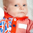 Stock Photo: Little British Olympic Team Supporter: newborn girl wearing Brit
