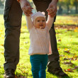 Happy baby girl with her father having fun in the park — Stock Photo