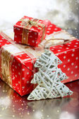 Christmas tree decoration and goft boxes on snowflakes and bokeh — Stock Photo