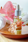 Essential oil for spa treatment in bottle with dropper, spa sett — Stock Photo