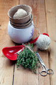 Bunch of fresh thyme with gardening and cooking utensils, on woo — Stockfoto