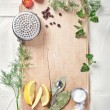 Kitchen utensils, spices and herbs for cooking fish on cutting b — Stock Photo #46056373