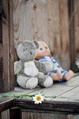 Childs toys left on a country house wooden porch — Stock Photo