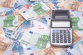 Belastingen concept - geld en rekenmachine — Stockfoto