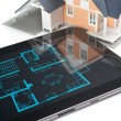 House and digital tablet — Stockfoto