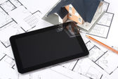 Blueprints, house and tablet — Stockfoto