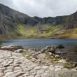 Landscape of footpath leading round Llyn Idwal with Devil's Kitc — Stock Photo #13377485