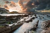 Sunrise ocean landscape Mupe Bay Jurassic Coast England — Stock Photo