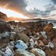 Stock Photo: Sunrise ocelandscape Mupe Bay Jurassic Coast England
