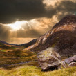 Stock Photo: Moody dramatic mountain sunset landscape