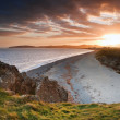 View along coast into beautiful setting sun — Stock Photo