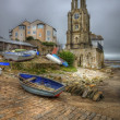 Lovely toned image of seaside town with rowing boat in foregroun — Stock Photo