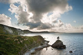 Sunrise ocean landscape Mupe Bay Jurassic Coast England — Stock Photo