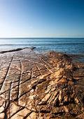 Kimmeridge bucht seelandschaft mit rock-simse verlängerung aus ins meer auf — Stockfoto