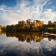 Beautiful sunset over Autumn Fall lake with crystal clear reflec — Stock Photo