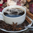 Steaming hot cup of coffee on Christmas background — Stok fotoğraf