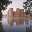 Stunning moat and castle in Autumn Fall sunrise with mist over m — Stock Photo #17854877