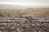 Autumn morning over liomestone pavement at Malham Cove looking a — Stock Photo