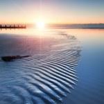 Beautiful low tide beach vibrant sunrise — Stock Photo #22630395