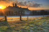 Vibrant Winter landscape sunrise over castle ruins — Stock Photo