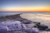 Winter sunset Kimmeridge Jurassic Coast. — Stock Photo