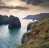 Beautiful sunset over secluded natural cove — Stock Photo