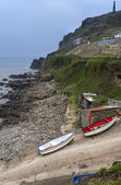 Buildings and boats on Cape Cornwall headland — Stock Photo
