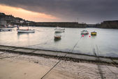 A traditional Cornish fishing village before sunrise in Cornwall England — Stock Photo