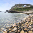 Stock Photo: Pebble beach and headland at Cape Cornwall
