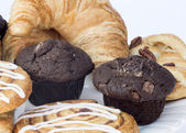Continental breakfast table setting with pastries and cakes — Stock Photo