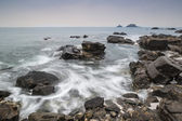 Rocky shore and Brisons Rock in distance at Cape Cornwall — Stock Photo
