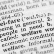 Macro image of dictionary definition of welfare — Photo