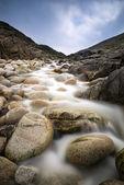 Stream feeding onto Porth Nanven beach Cornwall England — Stock Photo