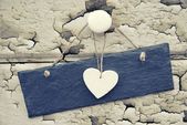 Macro retro cross processed effect image of hearts on wooden bac — Stock Photo