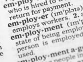 Macro image of dictionary definition of employment — Stock Photo