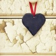Stock Photo: Macro retro cross processed effect image of heart on wooden back