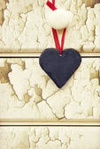 Macro retro cross processed effect image of heart on wooden back — Stock Photo