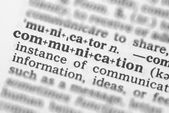 Macro image of dictionary definition of communication — Stock Photo